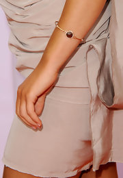 Ariana Grande paired her neutral dress with a gold bangle bracelet.