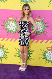Halston Sage chose this Art Deco-inspired geometric-print dress for her fierce and bold look at the KCAs.