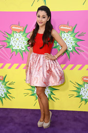 Ariana Grande chose this cute frock with a boatneck and full silk skirt for her purple carpet look at the KCAs.