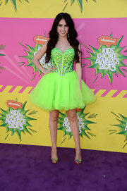 Ryan Newman chose a neon strapless dress with a beaded, sweetheart bodice for her princess-inspired look at the Kids' Choice Awards.