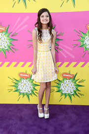 Ciara Bravo showed her sweet and youthful side with this age-appropriate yellow cocktail dress with lace daisy appliques.