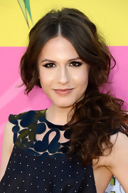 Erin Sanders pulled back her brunette curls into this low, messy ponytail.