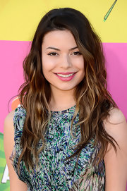 Miranda Cosgrove added a touch of fun and flirty color to her look with this bubblegum pink lip.
