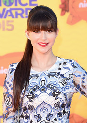 Elizabeth Elias wore a long, sleek ponytail with eye-grazing bangs when she attended the Kids' Choice Awards.