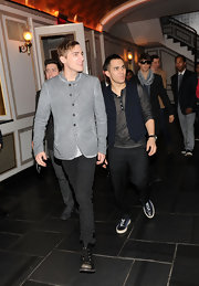 Kendall Schmidt's lace up boots toughened up his trendy outfit.