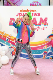 JoJo Siwa was sporty and cute in a rainbow track jacket at an event announcing her D.R.E.A.M. Tour.