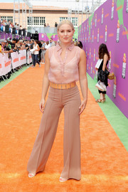 Lindsey Vonn teamed her blouse with a pair of nude wide-leg pants.