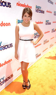 Daniella Monet paired her premiere night dress with bow-detailed chunky heels.