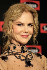 Nicole Kidman looked simply lovely wearing this loose ponytail while attending a Swisse event in Shanghai.