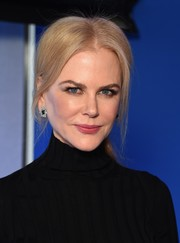 Nicole Kidman polished off her look with a pair of gemstone studs.