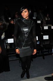 Taraji looks tough-chic in a collared leather vest at the Nicole Miller fashion show in NY.