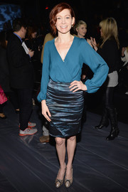 Carrie Preston donned a classic blue wrap top for the Nicole Miller fashion show.