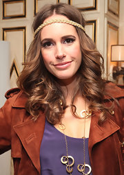 Louise Roe channeled the '70s with curly center parted locks. A gold braided headband finished off the bohemian look.