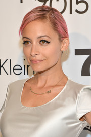 Nicole Richie rocked a slicked-down, pink-dyed hairstyle at the Future of Fashion Runway Show.