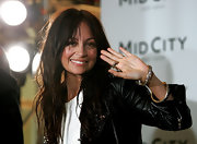 The always accessorized Miss Richie wore chunky gold bangles with her studded leather jacket.
