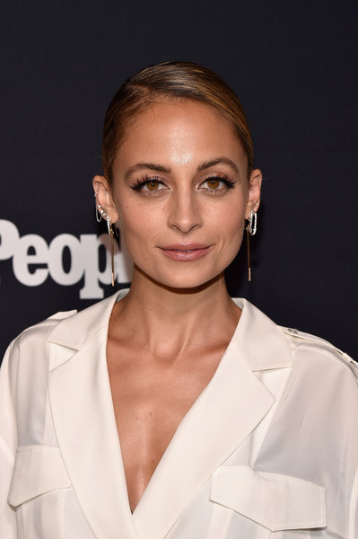 Nicole Richie Classic Bun [hair,face,hairstyle,eyebrow,lip,skin,chin,beauty,fashion,blond,arrivals,nicole richie,second floor,nyc,terra,entertainment weekly,people upfronts party,netflix,party,terra chips]