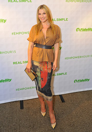 Ali Larter paired her shirt with a very stylish painterly-print pencil skirt.