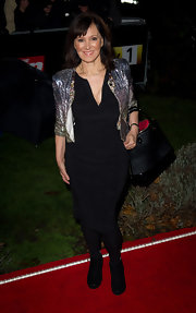 Arlene wears a sequined evening jacket with broad shoulders over her LBD.