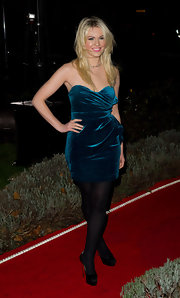 Zoe wears a blue velvet strapless dress with soft gathers.