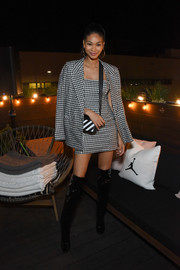 Chanel Iman punched up her look with a pair of black patent over-the-knee boots.