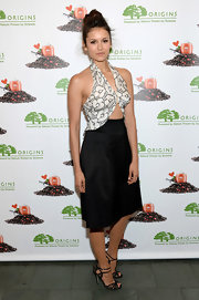 Nina rocked this super sexy cutout dress that featured a floral halter bodice and a sleek black skirt