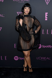 Dascha Polanco turned heads in a sheer black mesh dress by Wanda's Dream at the Elle Women in Music event.