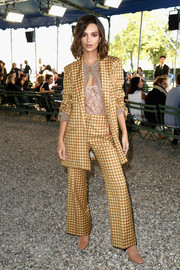 Emily Ratajkowski chose a gold checkered pantsuit by Nina Ricci for the label's Spring 2018 show.