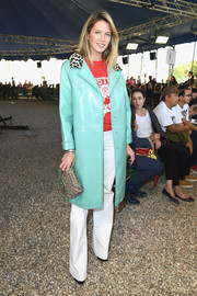 Helena Bordon arrived for the Nina Ricci Spring 2018 show wearing an aqua-green leather coat by Philosophy di Lorenzo Serafini.