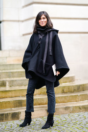 Emmanuelle Alt attended the Nina Ricci Fall 2018 show wearing a cute black lace-up poncho.