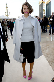 Jessica Alba looked demure in a white Nina Ricci wool coat layered over a sweater and a pencil skirt.