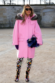 Anna dello Russo sealed off her eclectic-chic look with a blue fur purse by Fendi.