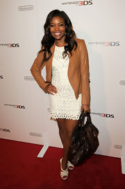 Gabrielle Union teamed her white crochet dress with white leather platform sandals.
