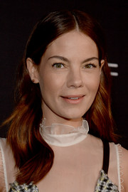 Michelle Monaghan wore her hair parted down the center with soft waves when she attended the Women in Film pre-Oscar party.