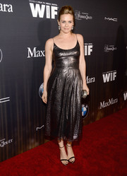 Alicia Silverstone shimmered in a gunmetal cami dress during the Women in Film pre-Oscar party.