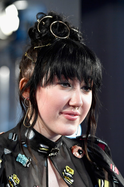 Noah Cyrus Hair Knot [hair,hairstyle,black hair,bangs,eyewear,uniform,smile,hair coloring,red carpet arrivals,noah cyrus,turner,iheartradio music awards,inglewood,california,tnt,tbs,the forum,trutv]