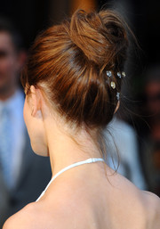 Emma Watson swept her hair up into a chic twisted bun for the London premiere of 'Noah.'
