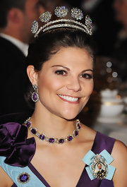 Crown Princess Victoria accessorized with a breathtaking collar necklace that matched the color of her dress.