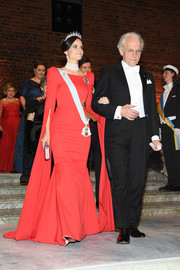 Princess Sofia of Sweden looked downright regal in a red mermaid gown with floor-length sleeves at the Nobel Prize Banquet 2018.