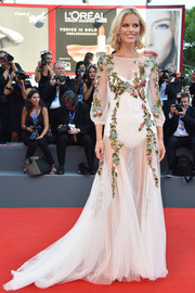 Eva Herzigova brought a dose of sex appeal to the Venice Film Fest premiere of 'Nocturnal Animals' with this sheer, floral-embroidered white gown by Alberta Ferretti.