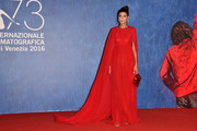 Giovanna Battaglia looked very queenly in a caped red gown while attending the Venice Film Festival premiere of 'Nocturnal Animals.'