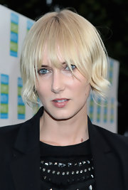 Here, Kimberly Stewart wore her hair in an inverted bob.  The back is cut short to an A-line.