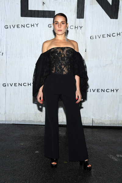 Noomi Rapace Slacks [shoulder,clothing,fashion,joint,fashion model,dress,fashion design,footwear,suit,fashion show,summer 2020,noomi rapace,front row,part,givenchy womenswear spring,paris,france,givenchy,paris fashion week,show]