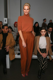 Poppy Delevingne went for a monochromatic look, pairing her sweater with burnt-orange slacks.