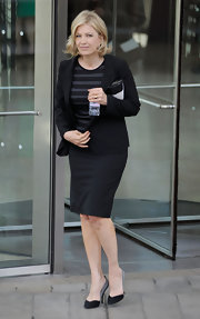 Diane Sawyer paired a black skirt suit with a striped shirt for Nora Ephron's memorial service.