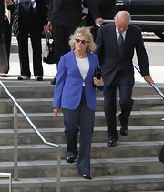 Candice Bergen knows that a classic blazer can keep from looking dated by injecting a bright pop of color into it.