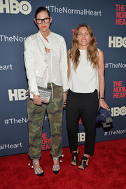 Jenna Lyons teamed a chic white cropped jacket with camo-print pants for the premiere of 'The Normal Heart.'
