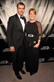 Sarah Ferguson carried a gorgeous satin clutch from Aruna Seth at the Novak Djokovic event.