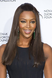 Naomi Campbell chose a half updo for her classic and elegant evening look at the Novak Djokovic Foundation Dinner.