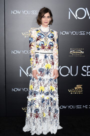 Lizzy Caplan went for old school glamour in a long-sleeve, high-neck embroidered gown by Erdem at the 'Now You See Me 2' world premiere.