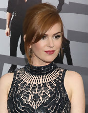 Isla Fisher's lovely red tresses looked shiny and chic pulled back into a perfectly styled messy ponytail.